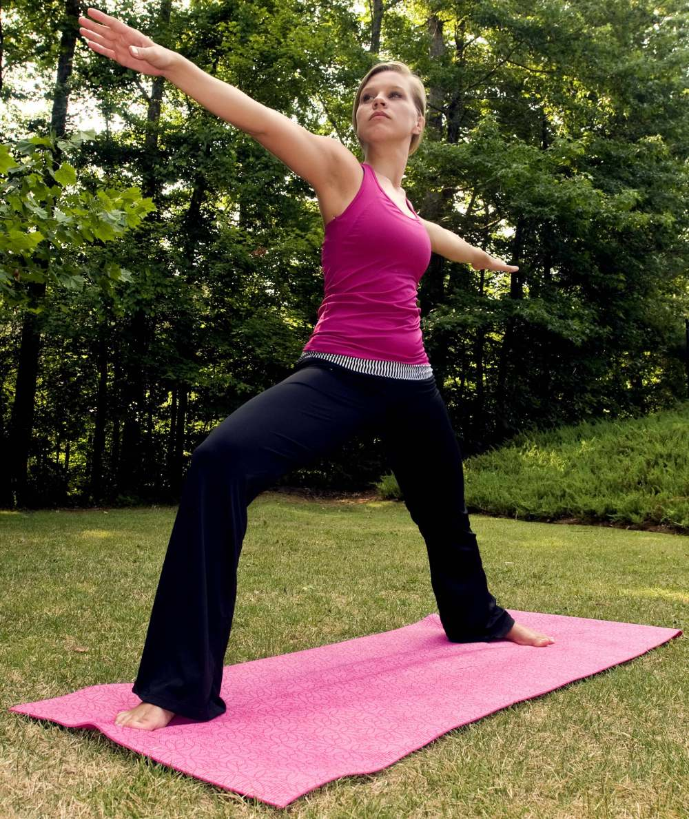 Woman exercise time by practicing yoga poses