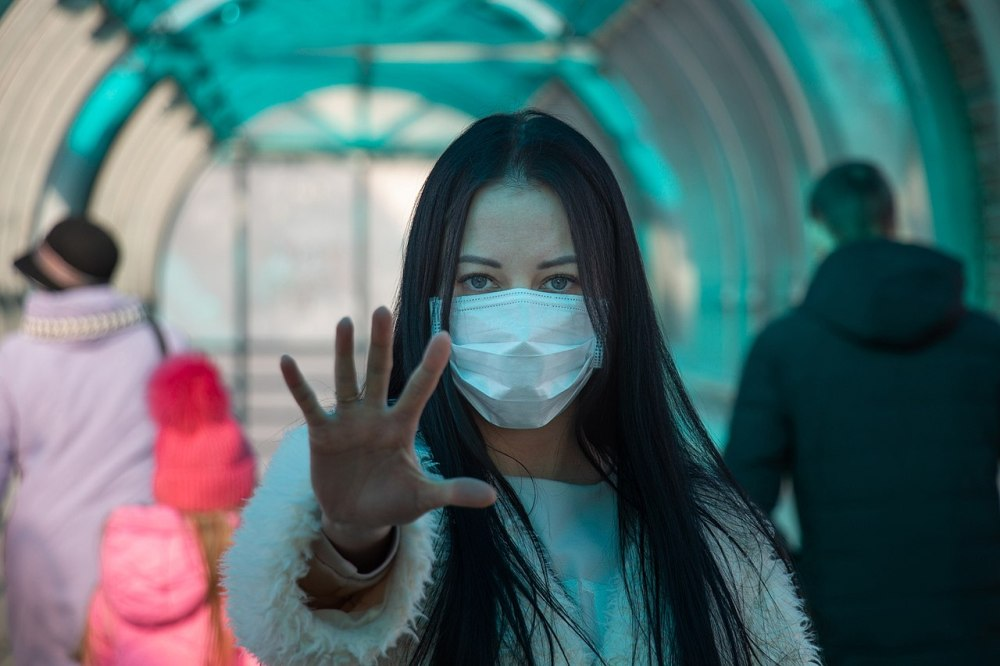 coronavirus covid-2019 Girl in mask on the street. Stop pandemic and panic
